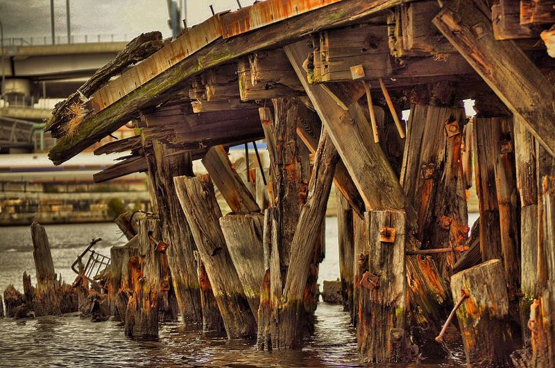Damaged wooden pier over sea