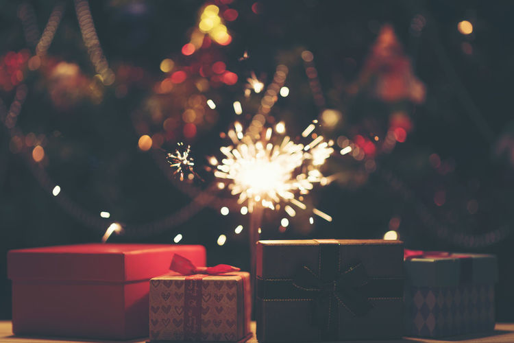 Close-up of christmas presents at night