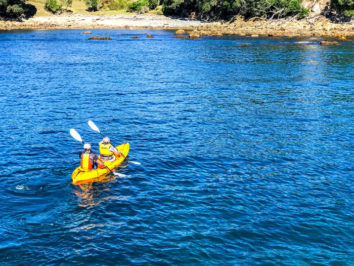 Kayaking Kayaking In Nature Beauty In Nature Blue Day Floating On Water High Angle View Kayak Leisure Activity Lifestyles Men Nature Nautical Vessel Outdoors People Real People Scenics - Nature Sea Togetherness Two People Water Waterfront
