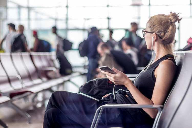 People using smart phone at airport