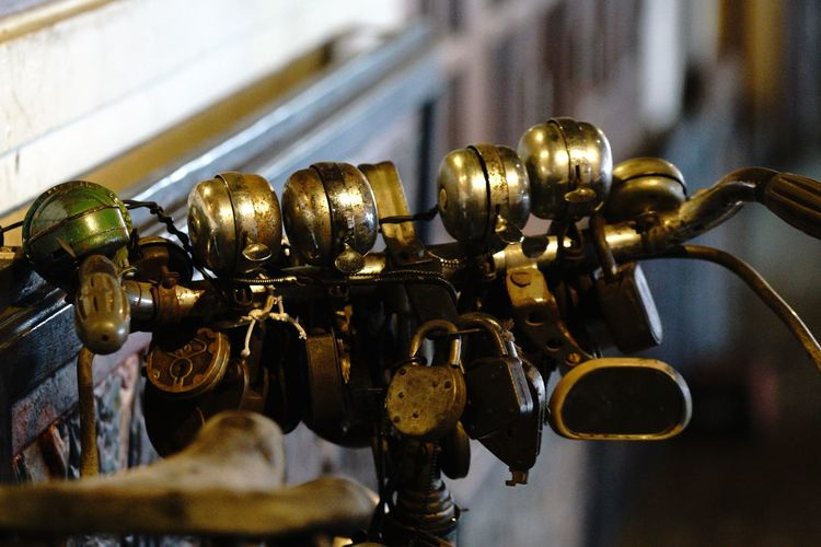 Close-Up Of Bells On Handlebar Of Bicycle