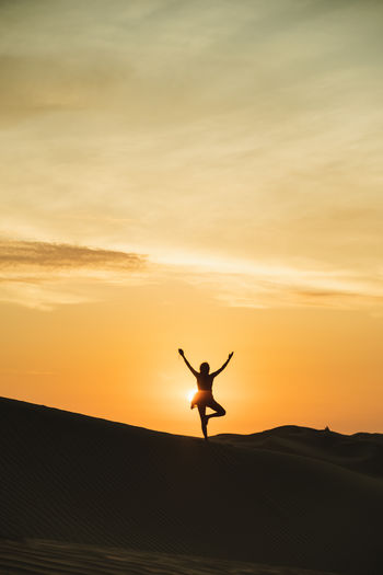 Sunset Silhouettes Sunset Yoga Yogapose Outdoors Silhouette Desert Landscape Woman Freedom Backlight Free One Person Happiness