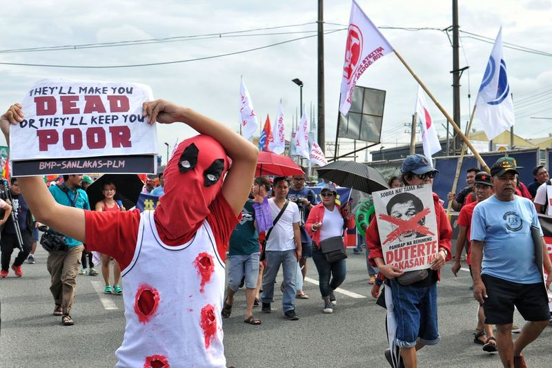 Along Commonwealth Avenue in Quezon City on July 23, 2018, protesters expressed their frustrations concerning the issues on War on Drugs, Extra Judicial Killings (EJK), Violence Againts Women, Housing for the Poor, Teachers' Salaries and Benefits by joining the rally during the 3rd State of the Nation Address (SONA 2018) of Pres. Rodrigo Duterte. EyeEm Best Shots The Week on E EyeEm Best Shots City Men Women Crowd Protestor Banner - Sign Poster Placard The Troublemakers The Photojournalist - 2018 EyeEm Awards