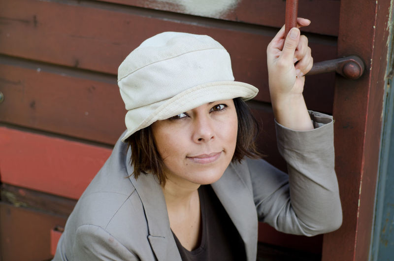 Woman with Hat Business Adult Beautiful Woman Businesswoman Clothing Focus On Foreground Front View Hat Headshot High Angle View Holding Human Hand Leisure Activity Lifestyles Looking At Camera One Person Portrait Real People Smiling Standing Women Young Adult Young Women