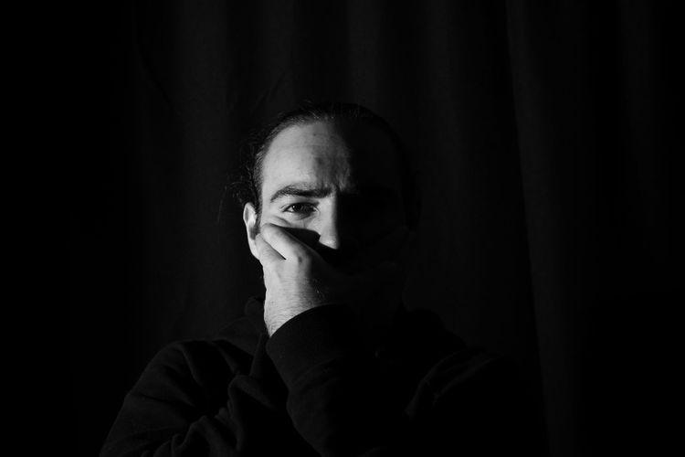 Portrait of young man in darkroom
