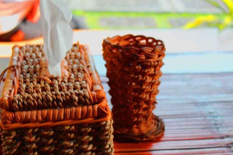 Close-up of wicker basket on table