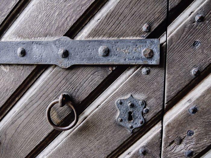 Metal ring hanging on wooden door