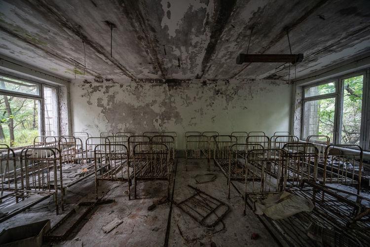 Abandoned cots in pripyat kindergarten