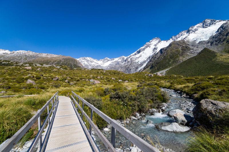 Footbridge Over Stream At Mount Cook National Park