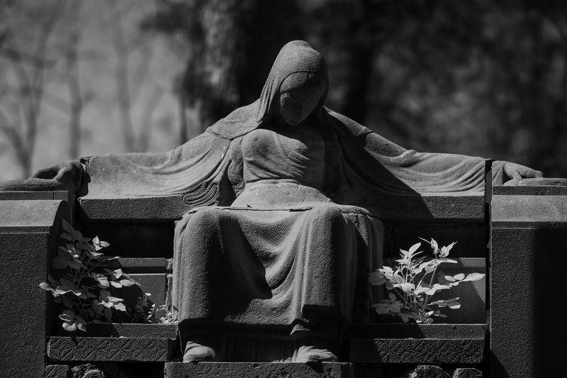 Human sculpture at graveyard
