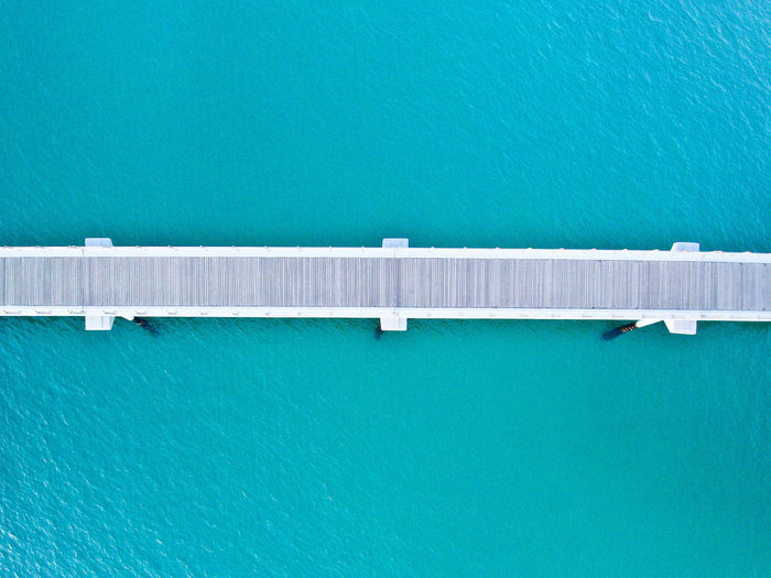 The bridge from drone view Drone  Architecture Blue Bridge Bridge - Man Made Structure Building Exterior Built Structure Connection Day Dronephotography High Angle View Nature No People Outdoors Sea Tranquility Turquoise Colored Water Waterfront