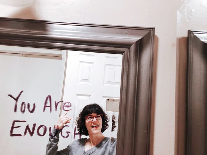 Yes I am One Person Indoors  Women Smiling Portrait Glasses International Women's Day 2019 Hairstyle Young Women Wall - Building Feature Front View Text Architecture Hair Real People Females Young Adult Adult Headshot Happiness