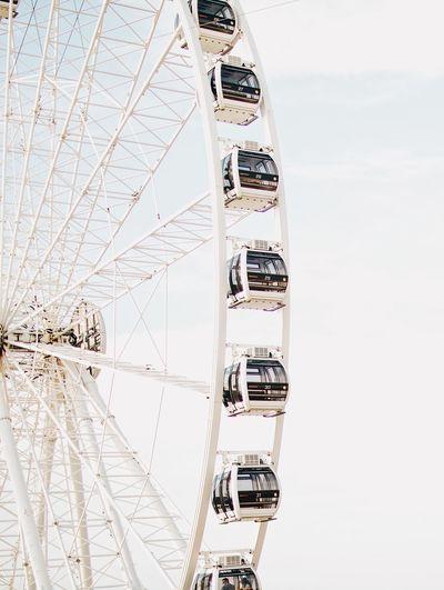 EyeEm Selects Sky Ferris Wheel Amusement Park Ride Amusement Park Day Nature Arts Culture And Entertainment Leisure Activity Outdoors Fairground Cloud - Sky Built Structure Water Copy Space Enjoyment Fun Architecture Real People Low Angle View