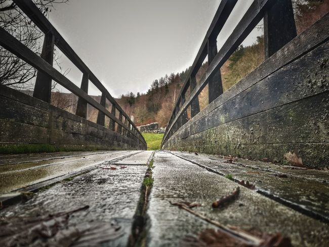 Into the distance...... To The Mine Wooden Bridge Forest Photography Welsh Countryside WoodLand Ruins Water Bridge - Man Made Structure Footbridge Wet Sky Architecture vanishing point Diminishing Perspective Pathway Walkway Woods Narrow The Way Forward Long