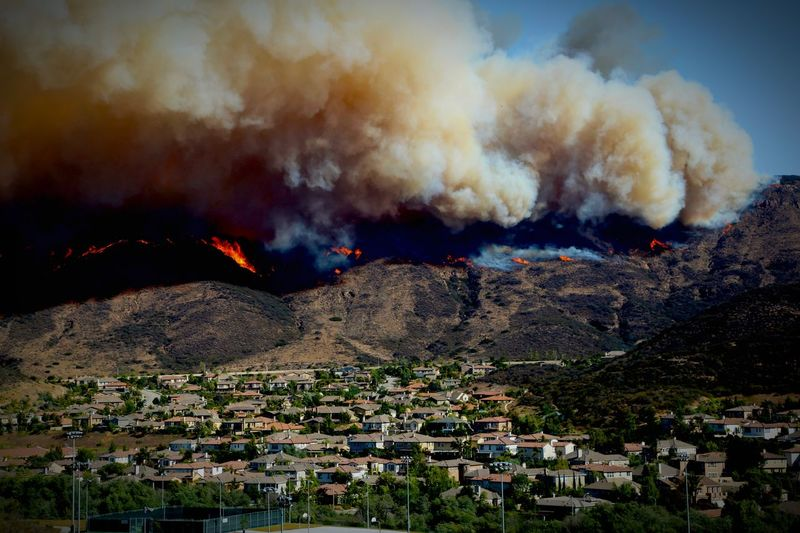 Smoke emitting from mountains during wildfire