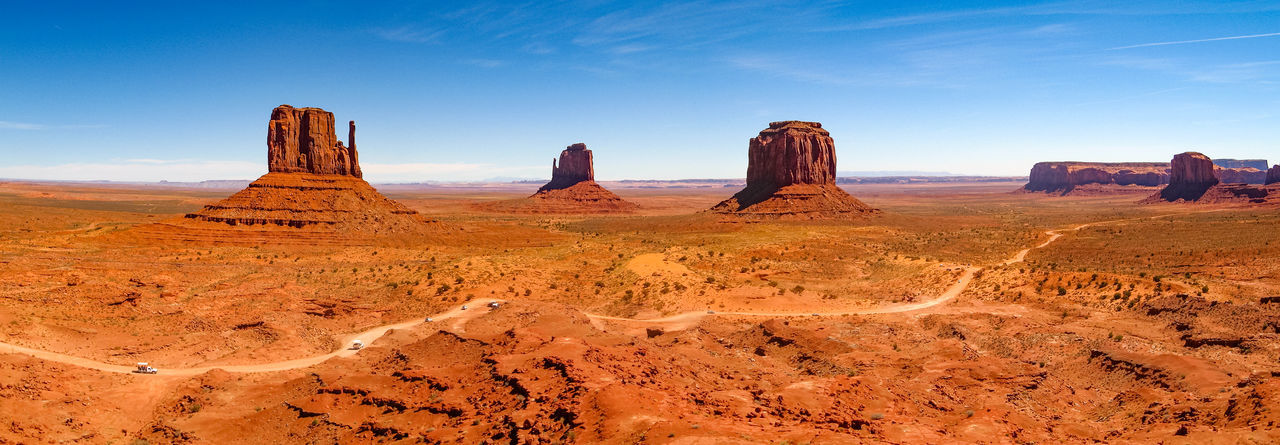 Arid Climate Barren Desert Eroded Extreme Terrain Geology Monument Valley Eroded Rocks Sandstone Rocks National Parks Geological Formations Rocky Landscape Sandstone USA Physical Geography Scenic Landscapes Rocky Mountains Wind Erosion Old West  Nature Panorama View Rock Formation The Old West Tourism Travel Destinations