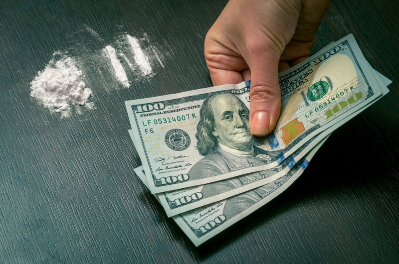 Cocaine Sniffing Money Currency Human Hand Finance Paper Currency Hand Business Human Body Part Wealth One Person Finger Human Finger Body Part Savings Human Representation Unrecognizable Person Holding Real People Economy Making Money