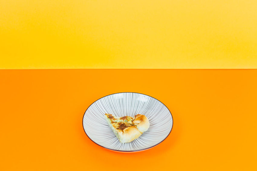Dish Zucchini Beige Background Close-up Colored Background Copy Space Day Egg Eggs Flower Head Food Food And Drink Freshness Healthy Healthy Eating High Angle View Indoors  No People Orange Background Orange Color Plate Quiche Ready-to-eat SLICE Studio Shot Sweet Food Vegetable Yellow Yellow Background