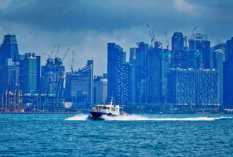 Singapore from the sea Cityscape Blue Boat Highrises Outdoors Sea Sky Waterfront