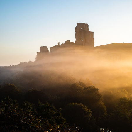 corfe castle in the early morning mist at sunrise Copy Space Dorset EyeEm Best Shots Tourist Attraction  Ancient Ancient Civilization Architecture Building Building Exterior Built Structure Castle Clear Sky Corfe Castle Fort History Mist Misty Morning Nature No People Old Ruin Outdoors Places To Visit Places You Must To See Plant Ruined Scenics - Nature Sky Sunrise The Past Tourist Destination Tranquil Scene Travel Travel Destinations Tree