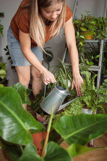 Midsection of woman holding plants