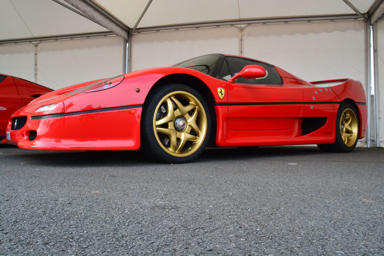 red, car, transportation, land vehicle, luxury, sports car, mode of transport, road, wheel, racecar, no people, auto racing, outdoors, day