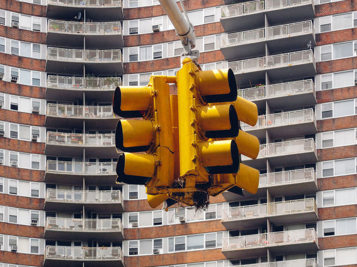 Low angle view of stoplight against buildings