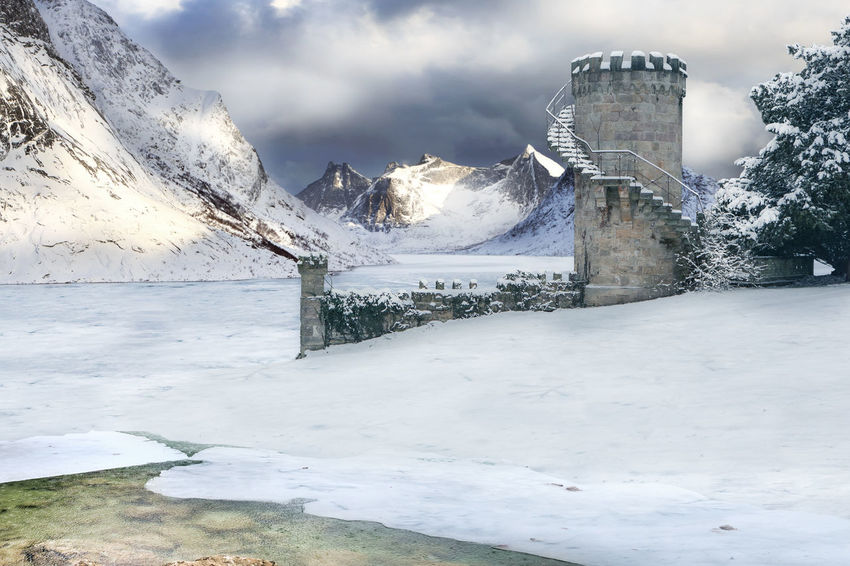A fantasy picture of an Icy Wasteland with an old Tower Barents Sea, Northern, Northland, Tower, Town, Arctic, Atlantic, Coast, Cold, Fantasy, Fjord, Game Of Throns Like, Harbor, Ice, Landscape, Mountains, Mystic, Nature, Nordic, North, North Sea, Norway, Ocean, Outdoor, Outdoors, Polar Circle, Scandinavia, Se Architecture Beauty In Nature Built Structure Cloud - Sky Cold Temperature Day Frozen Lake Landscape Mountain Nature No People Outdoors Scenics Sky Snow Tranquil Scene Tranquility Tree Water Weather Winter