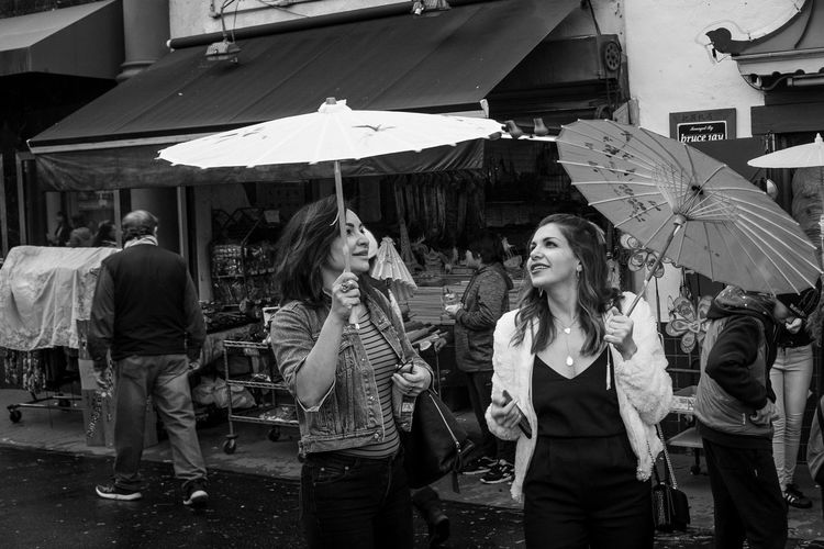 Photo444 Streetphotography Beauty Portrait Black And White Blackandwhite Fujifilm Fujix100f Documentary Fujifilm_xseries City Architecture Real People Adult Young Adult Women Leisure Activity