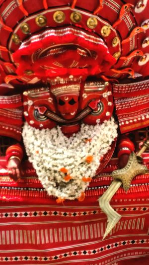 Theyyam is one of the famous Festivals in Malabar region of Kerala.Theyyam season starts from November and ends arround March. red Celebration Cultures Close-up God Supernatural Temple Art Arts Culture And Entertainment Ritual Rituals & Cultural Fierce Scary