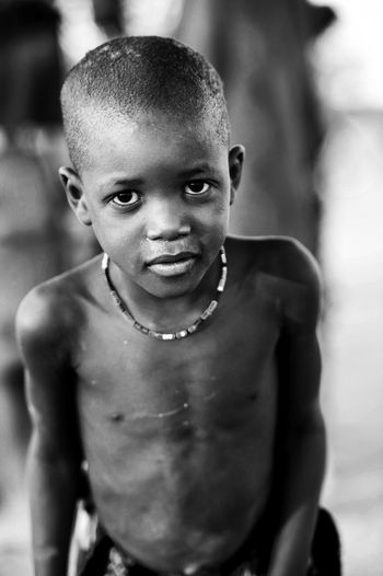 Africa African Cheerful Child Childhood Cultures Front View Happiness Himba Looking At Camera Outdoors People Poor  Portrait Tribe