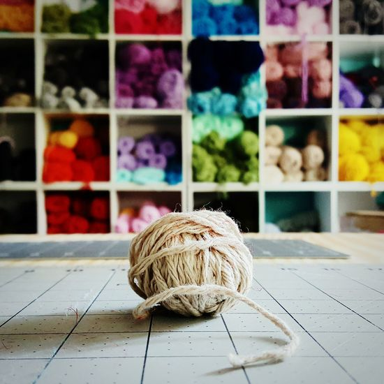 Close-up of wool ball on table