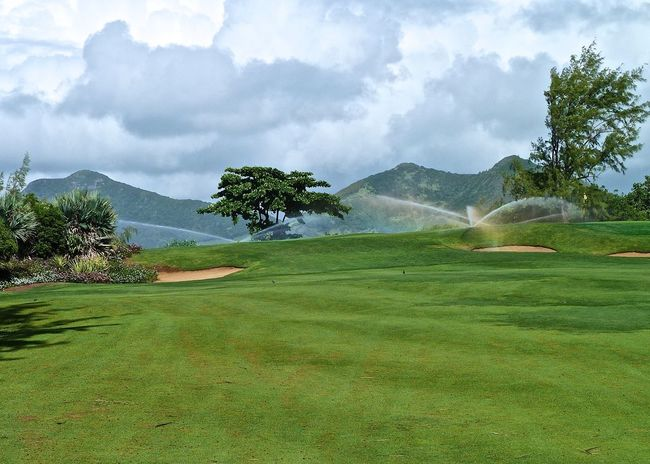 Beauty In Nature Cloud - Sky Enjoying Life Fairway Golf Golfcourse Grass Green Green Color Growth Idyllic Landscape Landscapes With WhiteWall Leisure Activity Mauritius Mountain Range Nature Scenics Sports Photography Taking Photos Tranquil Scene Travel Tree Wineandmore Île Aux Cerfs