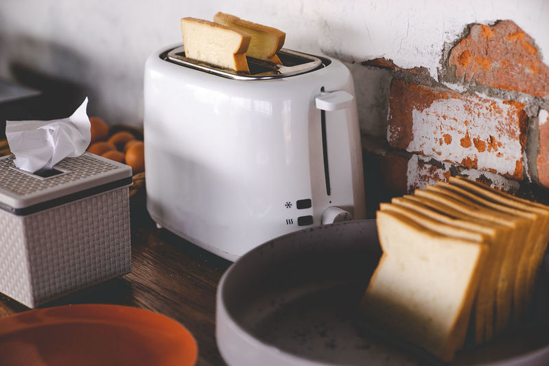 High angle view of bread in toaster on table