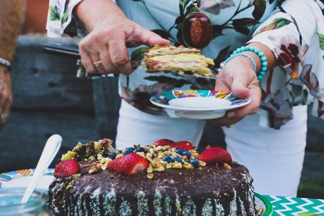 Serving up slices of birthday cake Sweet Food Indulgence Temptation Dessert Food Food And Drink Unhealthy Eating Freshness Two People Cupcake Cake Men Midsection Ready-to-eat Birthday Cake Outdoors Close-up Human Hand Dessert Topping Human Body Part Celebration Women Around The World