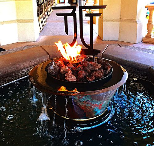 Water fountain with burning fire Fire Burning Hot Heat Flame Fireplace Coal Water Fountain Water Water Flow Water Dripping Interior Style Interior Design Architecture Container San Francisco East Bay California Colour Of Life Eyeemphoto
