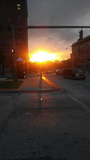 sunset in the city Baltimore City New To EyeEm City Sunset Sunset City Cityscape Sunset Urban Skyline Sun Sky Architecture Building Exterior Cloud - Sky Built Structure City Street Dramatic Sky Zebra Crossing Vehicle Romantic Sky