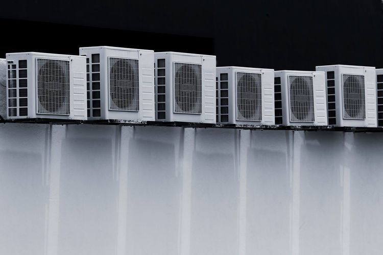 Row of air conditioning at the wall.