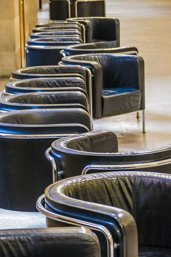 Empty chairs on floor in waiting room