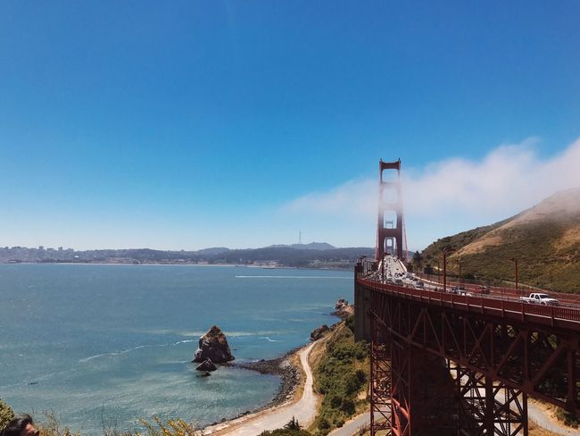 Connection Built Structure Architecture Bridge - Man Made Structure Day No People Water Outdoors Mountain Blue Nature Transportation Travel Destinations Sky Scenics Sea Beauty In Nature Clear Sky San Francisco Golden Gate Bridge Fog Clouds And Sky Cloud - Sky