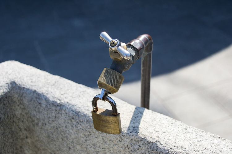 Close-up of tap locked with padlock