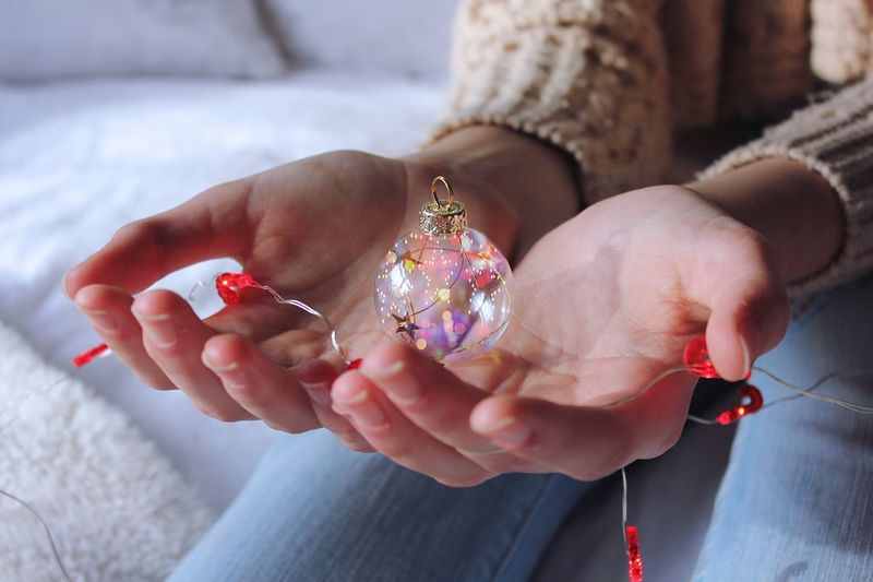 Human Hand Real People Human Body Part One Person Women Holding Indoors  Focus On Foreground Close-up Lifestyles Nail Polish Low Section Day Adult People Christmas Tree Christmas Decoration Christmas Ornament Christmas Lights Snow Lights Winter Warm Be. Ready.