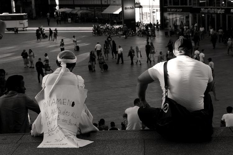 People sitting on city street