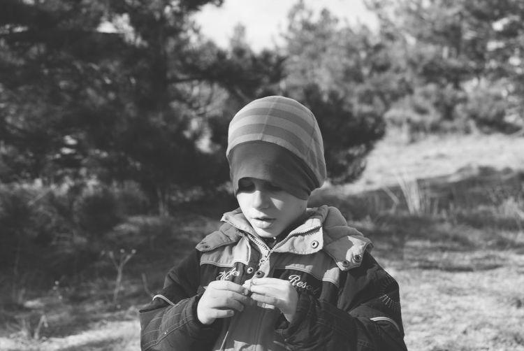 Boy wearing warm clothing on field