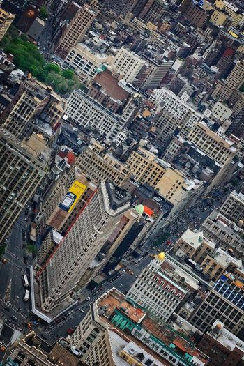 High angle view of flatiron building amidst towers in city
