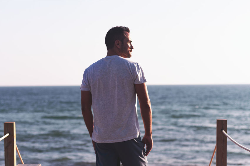 Beauty In Nature Casual Clothing Horizon Horizon Over Water Leisure Activity Lifestyles Looking At View Men Nature One Person Outdoors Real People Scenics - Nature Sea Sky Standing Three Quarter Length Water Young Adult Young Men
