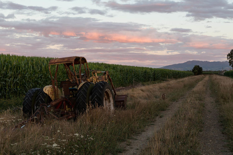Agriculture Beauty In Nature Cloud - Sky Day Farm Landscape Nature No People Outdoors Rural Scene Sky Sunset Tractor