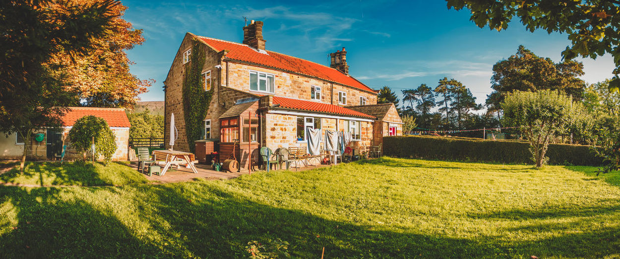 A panoramic image of a cottage in North Yorkshire, England. Blue Sky Colors Cottage Cottage Life Countryside England English Countryside Front Yard Green Grass Laundry Day Light And Shadow Panorama Panoramic Picnic Table Summer Summer Light Sunset Tile Art Tree Uk