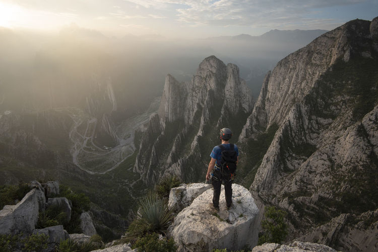 Full length of man on rocks against mountains