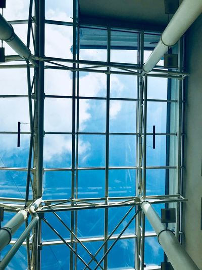 Low angle view of glass window of building